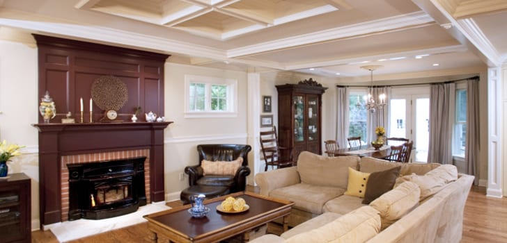 living room with custom fireplace surround