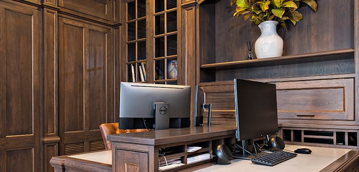 home office with built in desk and custom cabinetry