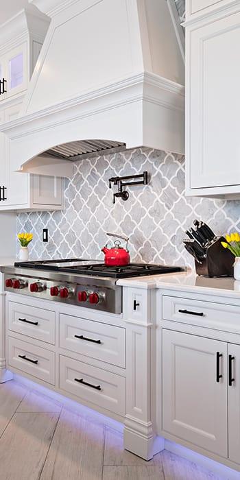white cabinetry around range area in kitchen